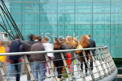 1146224410istockphoto Business People Walking on Footbridge in Canary Wharf, London, UK 171576568