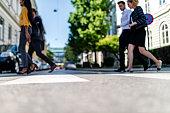 Business people walking on pedestrian crossing