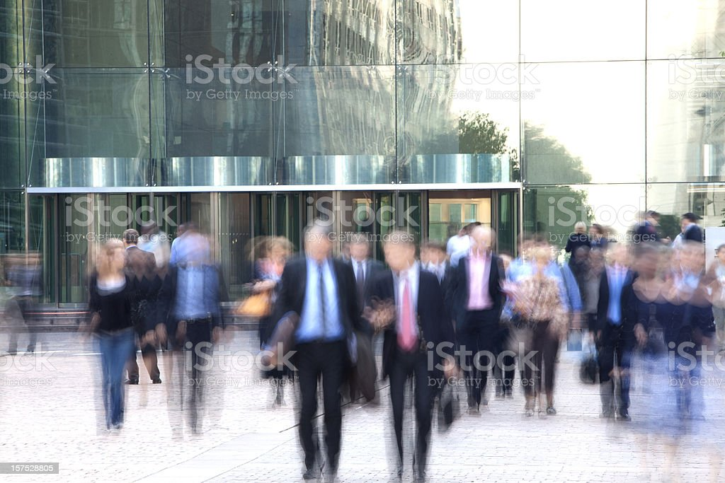Business people walking out of an office building, blurred motion royalty-free stock photo