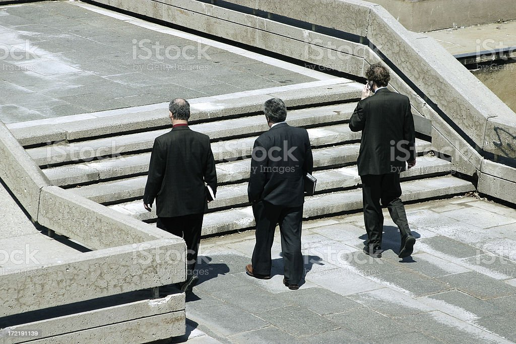 Business people walking outdoors royalty-free stock photo