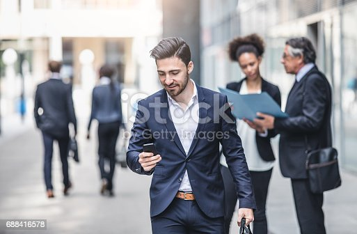istock Business People Walking Outside The Business Building 688416578