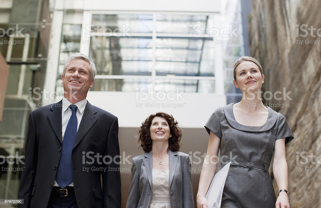 Business people walking royalty-free stock photo