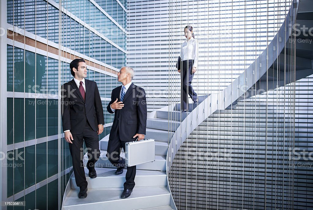 Business people walking the stairs and talking royalty-free stock photo