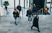 istock Business people walking through a office hallway 1304871532