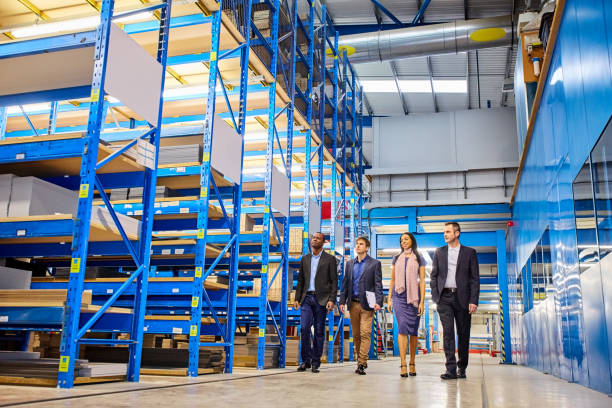 Business people walking through warehouse – Foto