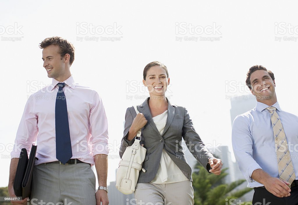 Business people walking together outdoors royalty-free stock photo
