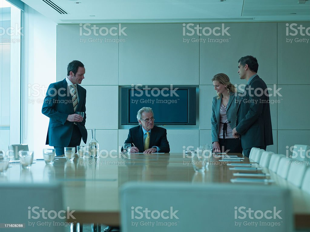 Business people watching boss sign contract royalty-free stock photo