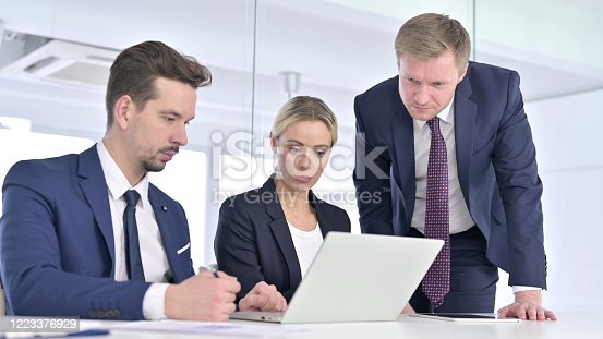 944493796 istock photo Business People Watching on Laptop in Office 1223376929
