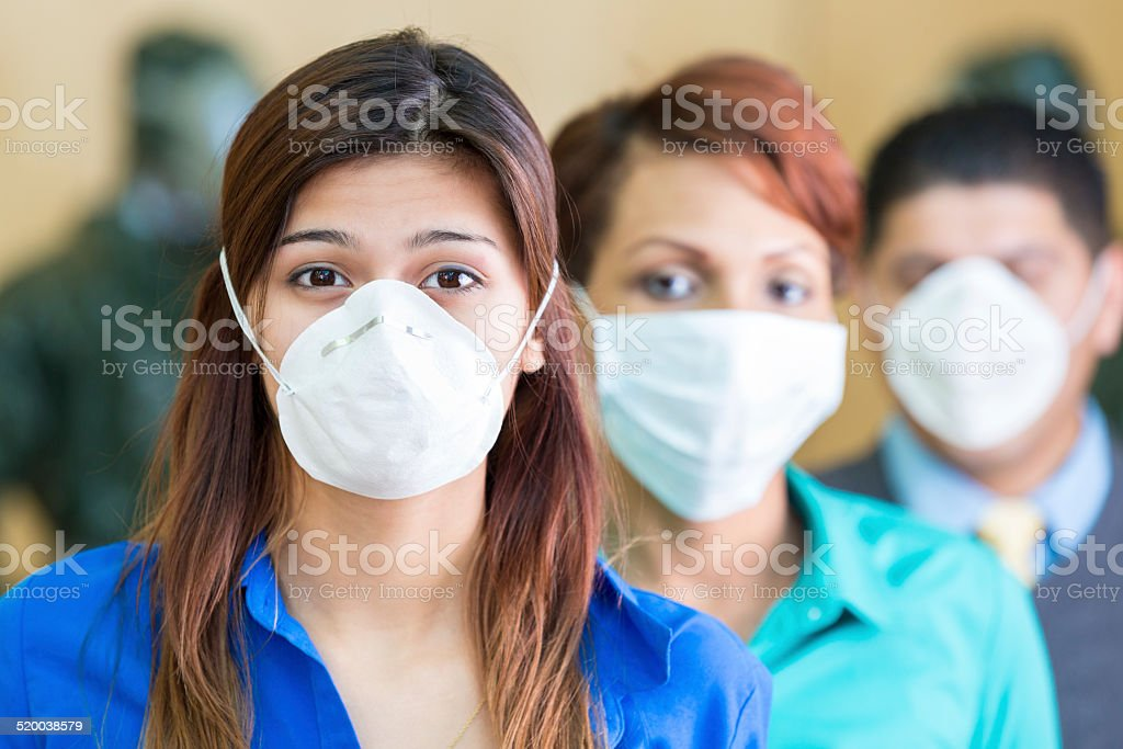 Business people wearing medical masks during flu or contagious pandemic stock photo