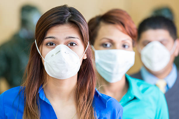 Business people wearing medical masks during flu or contagious pandemic Business people wearing medical masks during flu or contagious pandemic  epidemic stock pictures, royalty-free photos & images