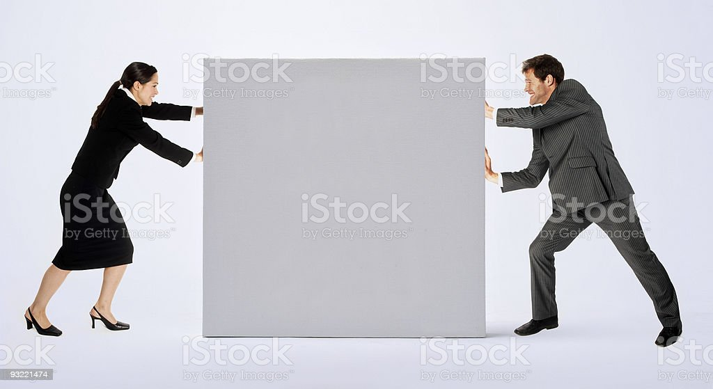 Business people with blank sign royalty-free stock photo