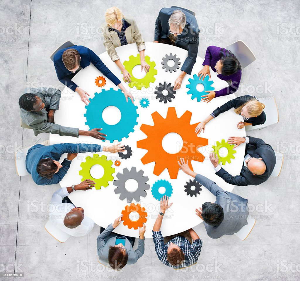 Business People with Gears and Teamwork Concept stock photo