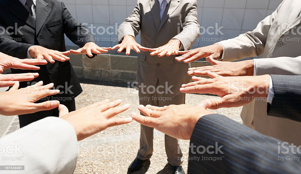 Business people with hands joined royalty-free stock photo