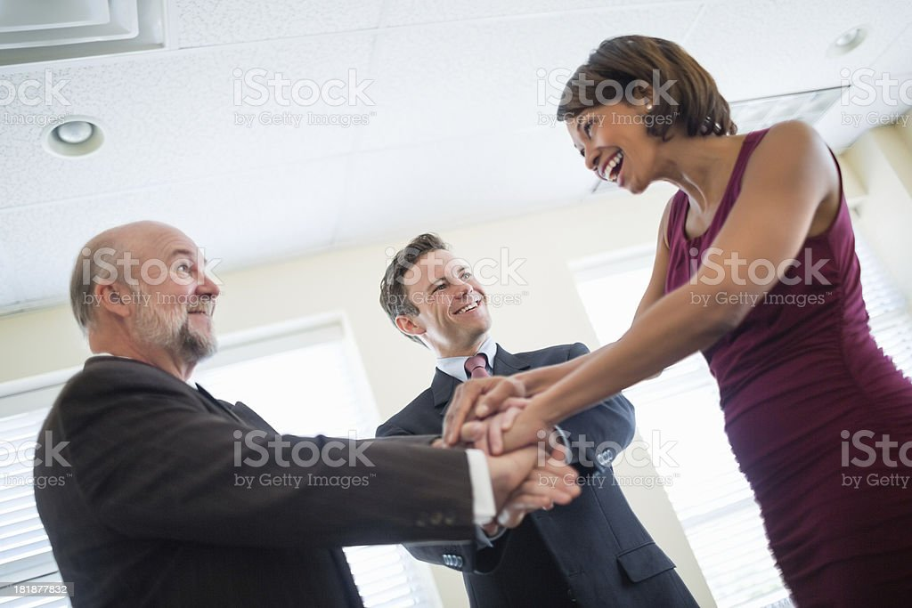 Business People With Hands Together Showing Unity royalty-free stock photo