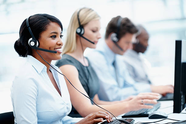 Business people with headset on working in a call center  call centre photos stock pictures, royalty-free photos & images