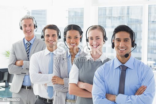istock Business people with headsets smiling at camera 813556520