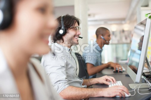 istock Business people with headsets working at computers in office 170153122