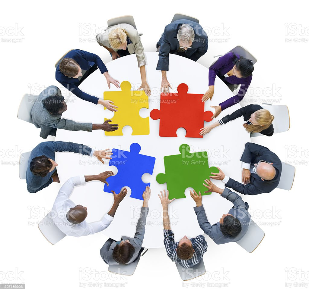 Business People with Jigsaw Puzzle and Teamwork Concept stock photo