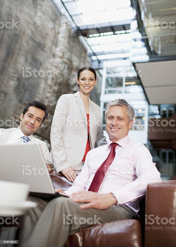 Business people with laptop in lobby royalty-free stock photo