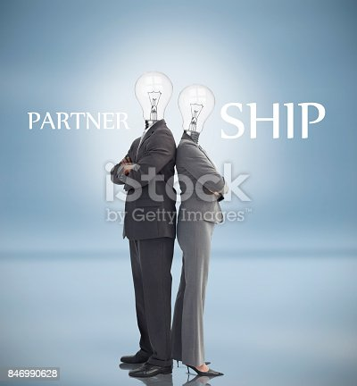 istock Business people with light bulbs instead of heads and partnership text 846990628