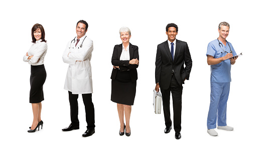 Smiling Business executives standing with medical staff isolated over white background