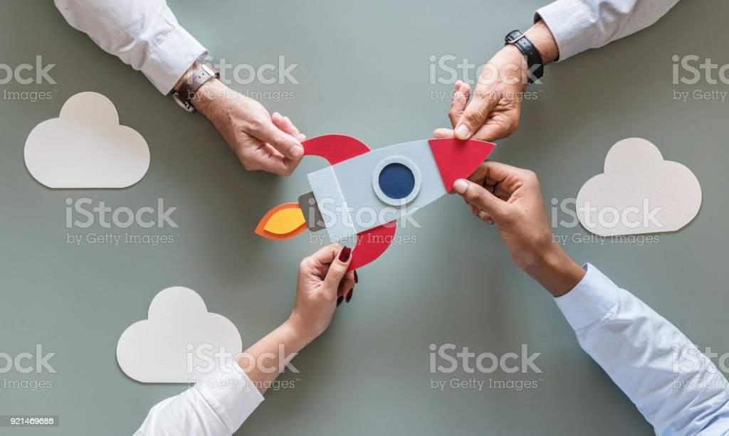 Business people with startup rocket royalty-free stock photo