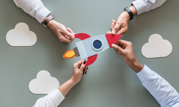 Business people with startup rocket stock photo