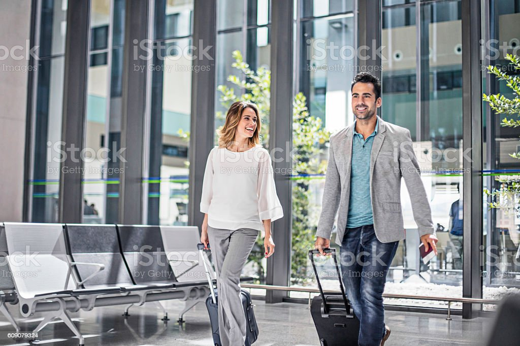 Business people with suitcases in airport stock photo