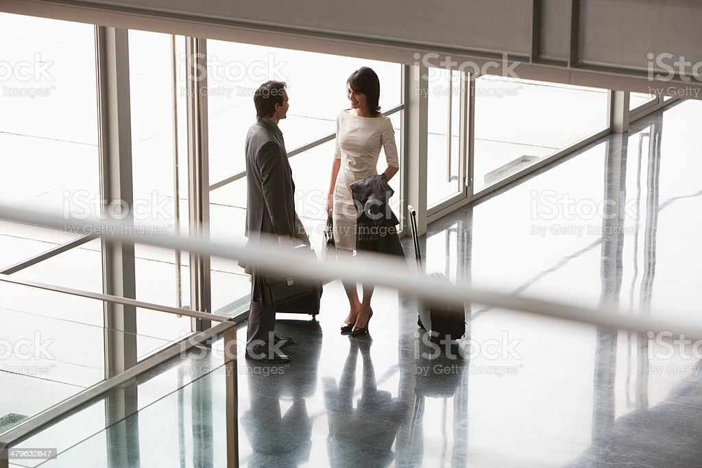 Business people with suitcases in building lobby stock photo