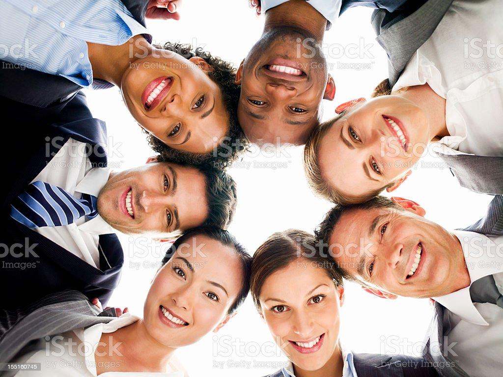 Business People with their Heads Together royalty-free stock photo