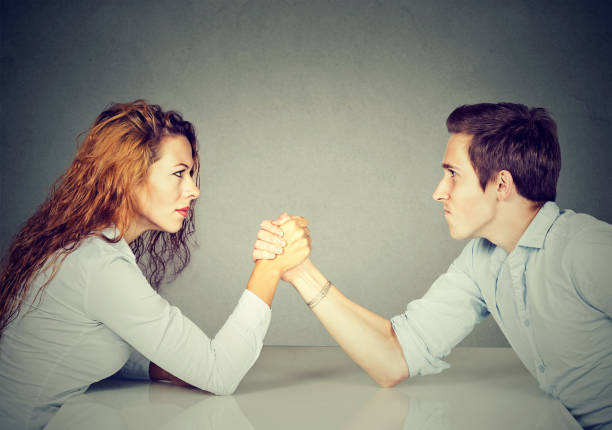 business people woman and man arm wrestling - battle of the sexes concept stock pictures, royalty-free photos & images