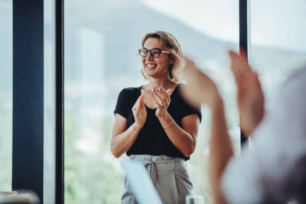 Business people women applauding after productive meeting stock photo
