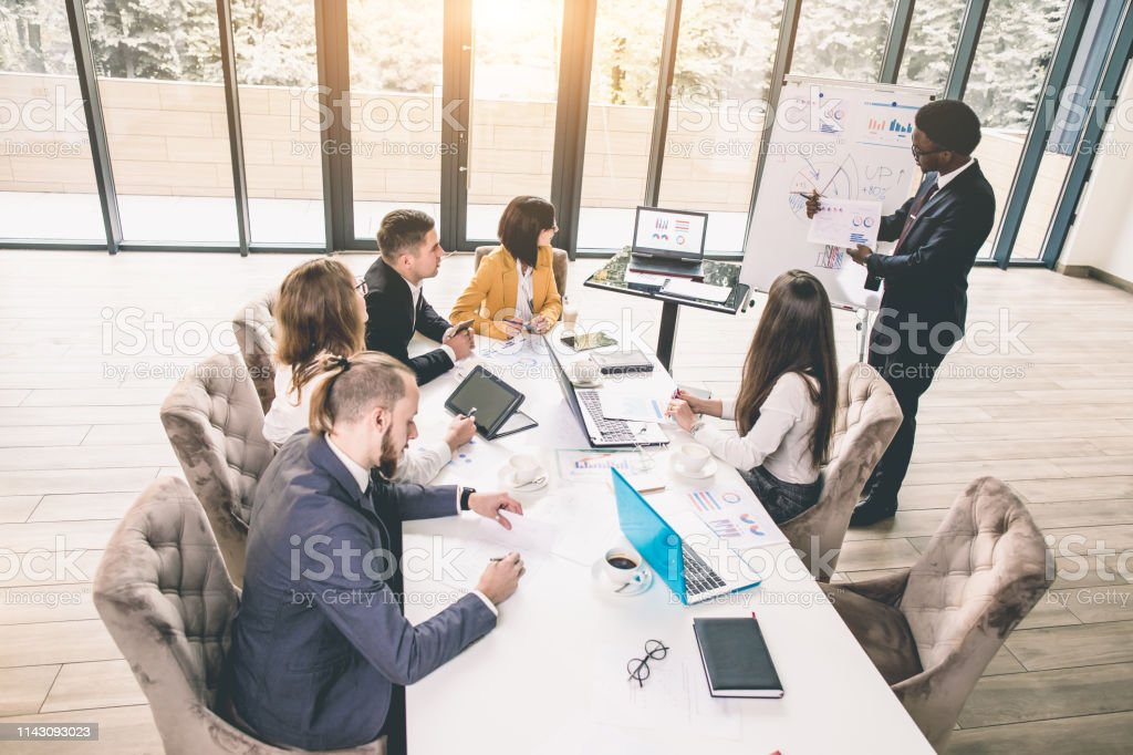 Business people working as a team at the office. Young African...