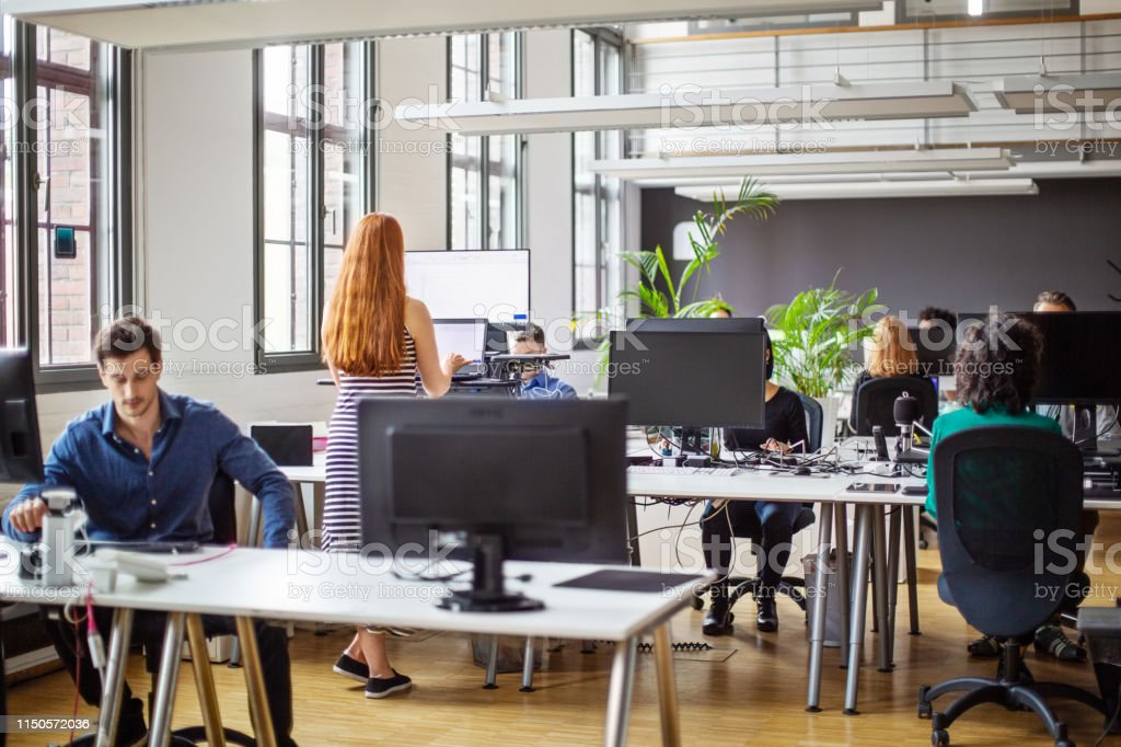 Business people working at a busy open plan office - Royalty-free Adult Stock Photo