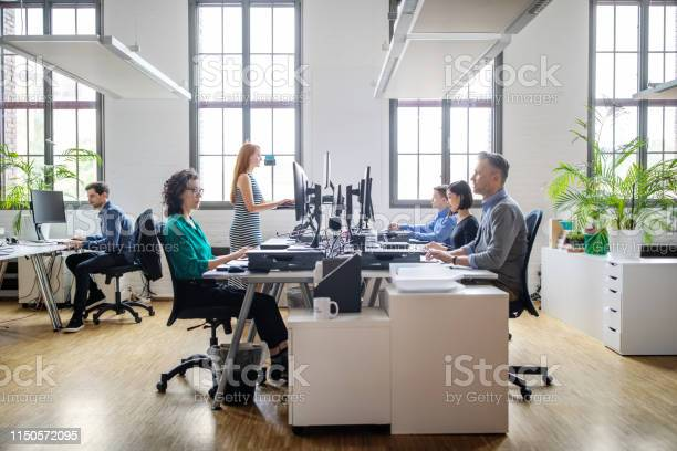 Business People Working At A Modern Office Stock Photo - Download Image Now