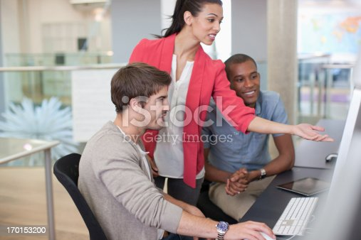 istock Business people working at computer in office 170153200