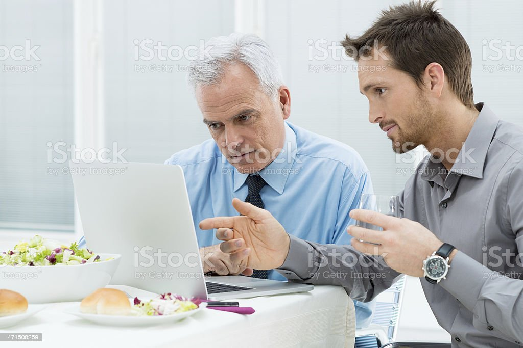 Business People Working at Lunch stock photo