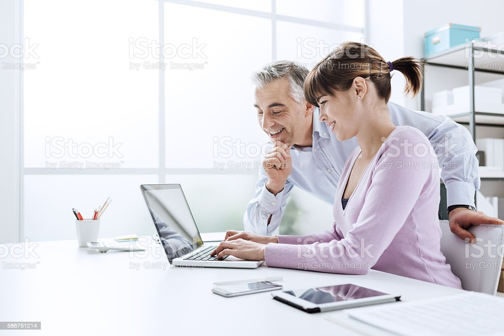 Business people working at office desk - Royalty-free Adult Stock Photo