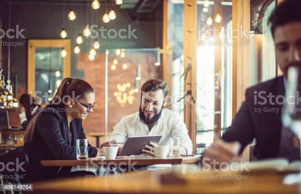 Business people working at the cafe restaurant picture id656149254?b=1&k=6&m=656149254&s=612x612&h=tzsjrft4biicbpgchhyehrqoicxw6eixwpw4fwfhwwi=