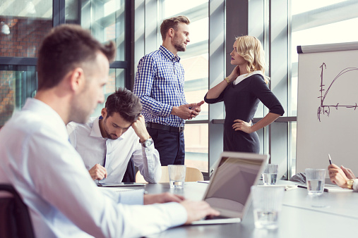 Business People Working In An Office Stock Photo - Download Image Now