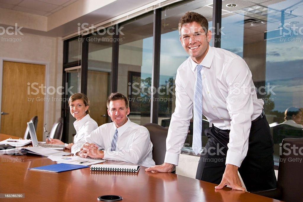Business people working in boardroom, focus on man royalty-free stock photo