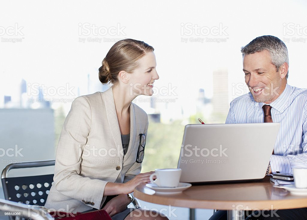 Business people working in cafe royalty-free stock photo