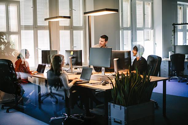 business people working in modern office space - flächeninhalt stock-fotos und bilder