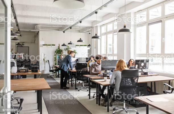 Business people working in modern office space picture id973718370?b=1&k=6&m=973718370&s=612x612&h= dmmbmt7ex3hqnx wlhr3xnjiosindk4ctmuljnmhlu=