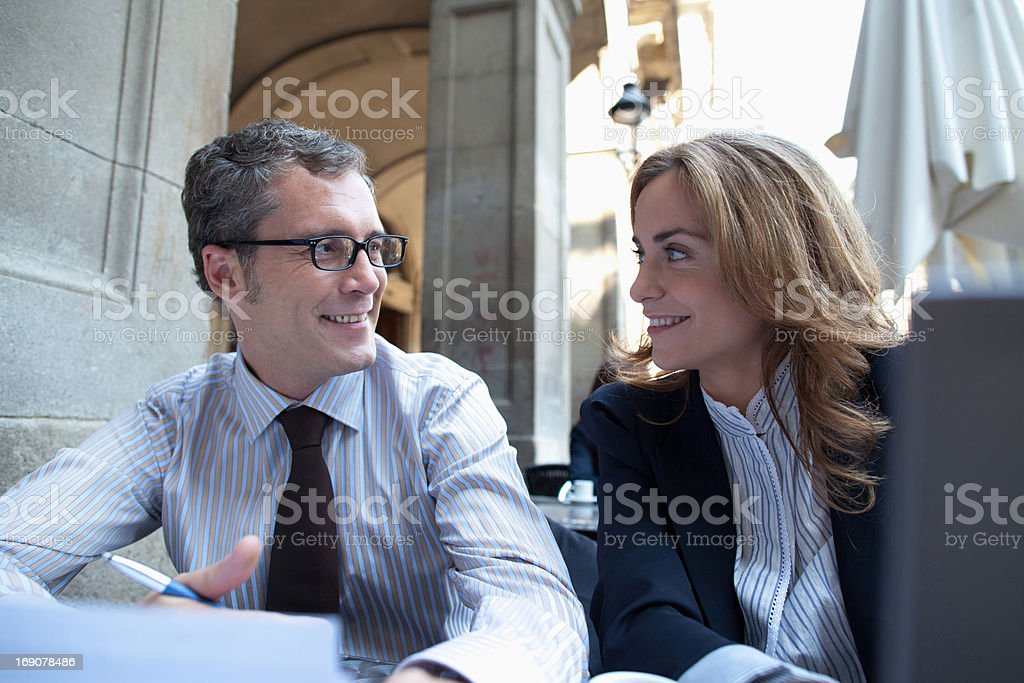Business people working in sidewalk cafe royalty-free stock photo