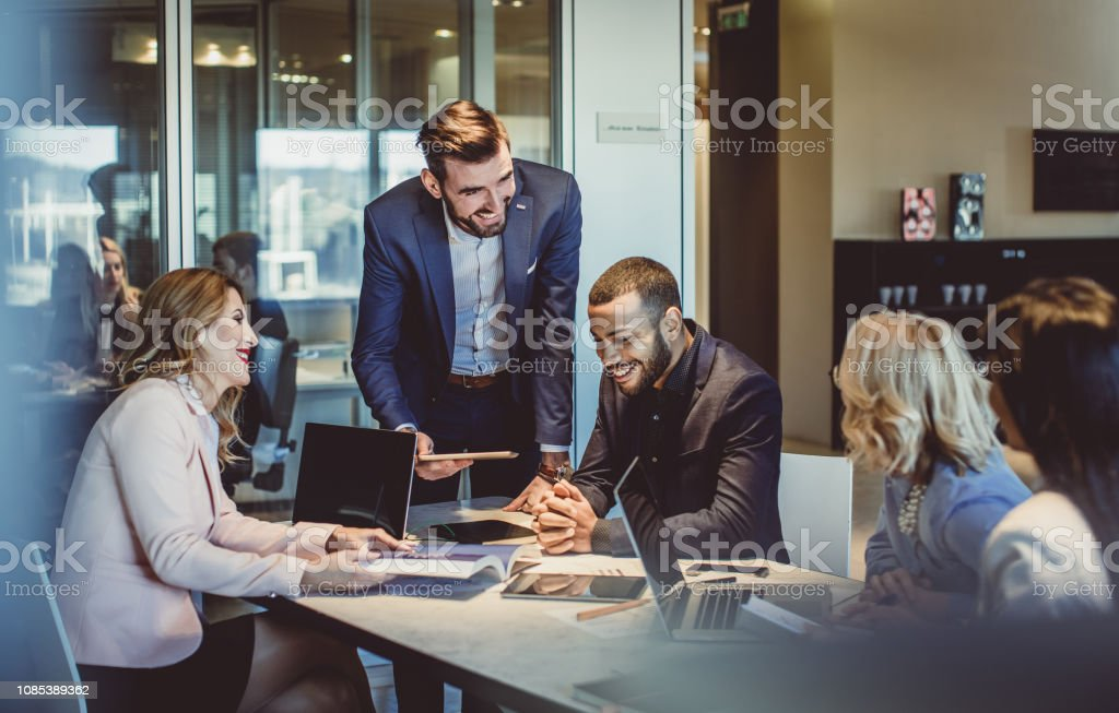Business People Working in The Office Business People Working in The Office Adult Stock Photo
