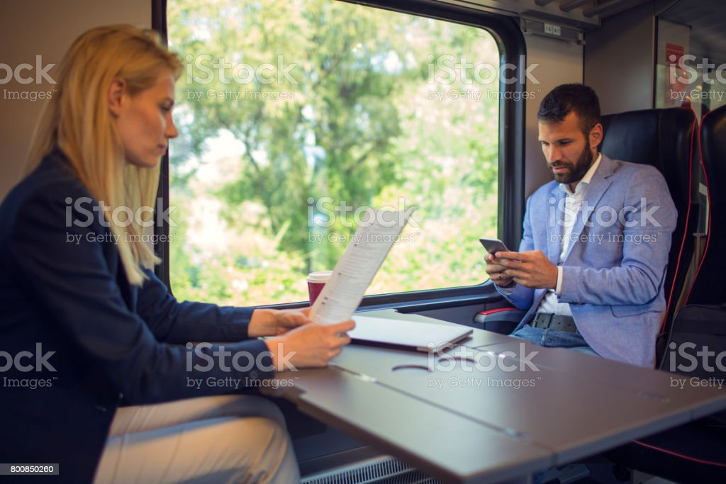Business people working in the train stock photo