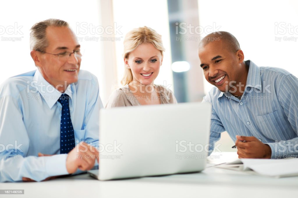 Business people working on a laptop. stock photo