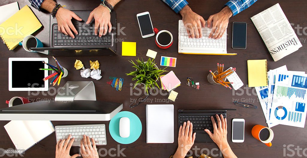 Business People Working on an Office Desk stock photo