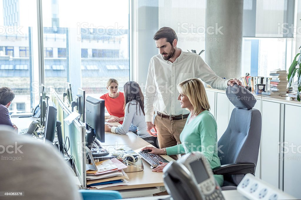Business people working on computer in modern office - Royalty-free 2015 Stock Photo